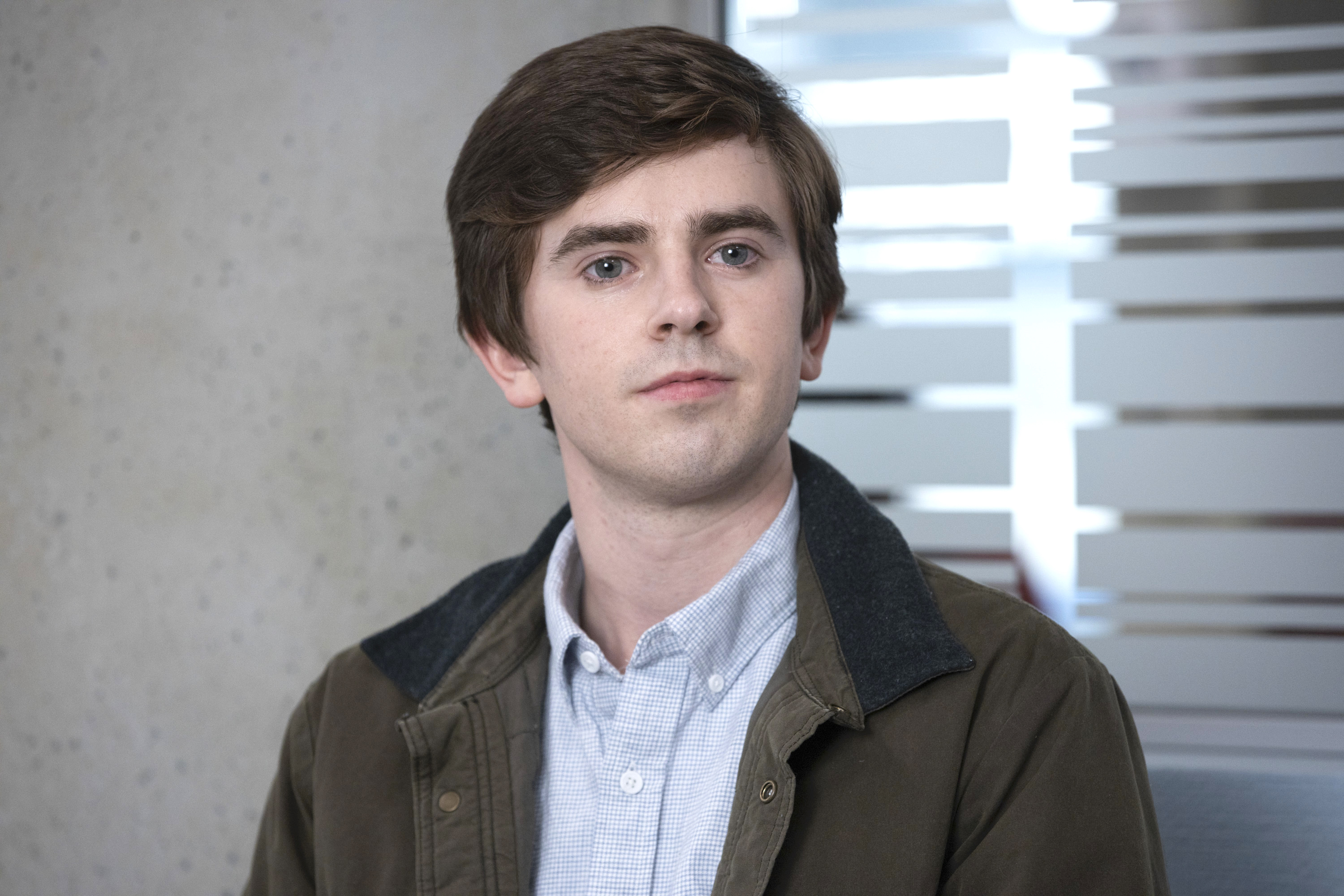 A still from the TV show 'The Good Doctor' showing the main character Dr. Shaun Murphy played by Freddie Highmore.