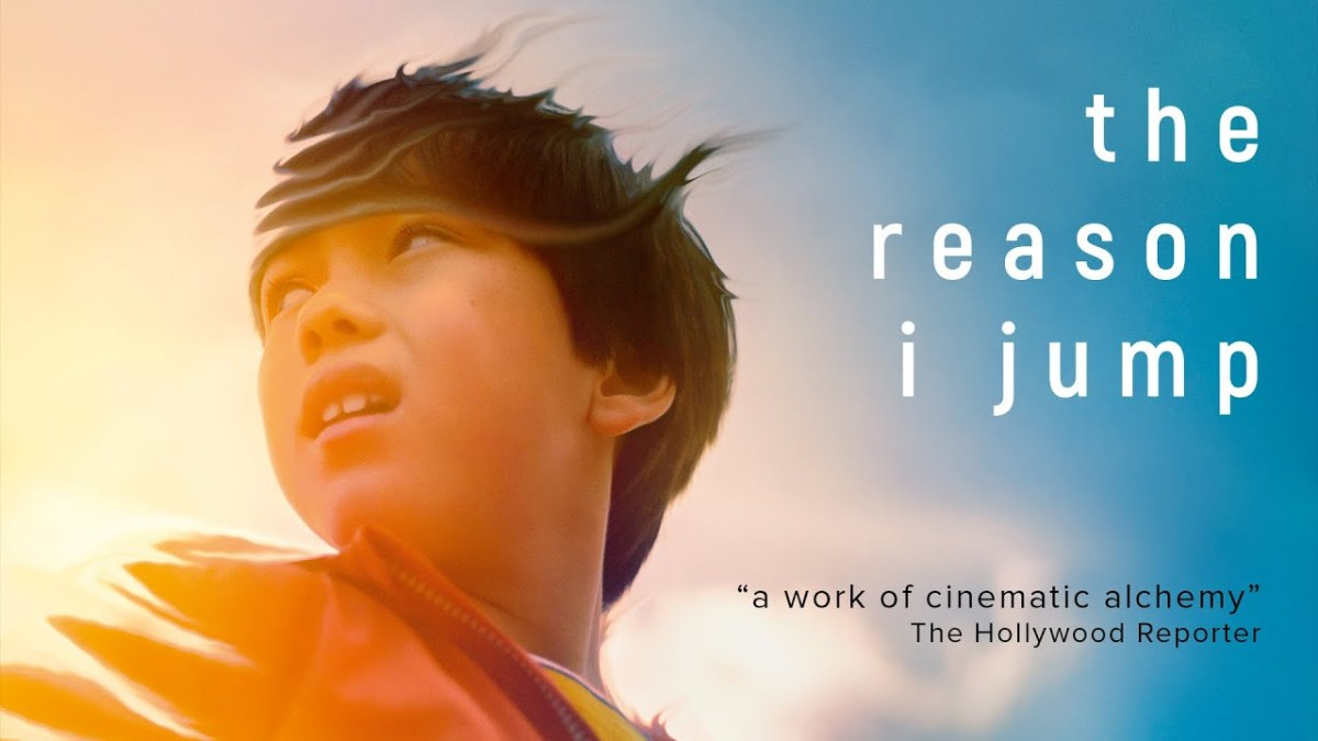 """Movie Screenshot of the reason i jump, close up of a young boys face as he looks behind him. Text reads: the reason I jump. """"A work of cinematic alchemy"""" the hollywood reporter."""
